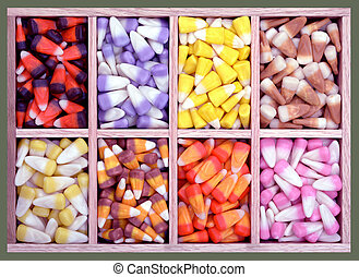 candy corn - colorful assorted candy corn in wooden tray