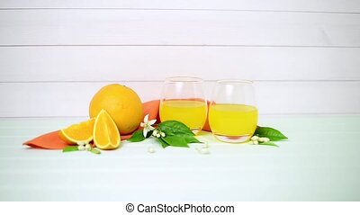 Freshly squeezed orange juice on wood background