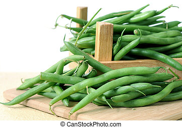 green bean with crate on cutting board