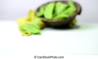 Broad beans of peas on light green wood table background.