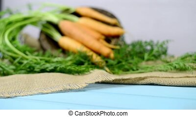 Carrots on a wooden table - Carrots on a turquoise blue...