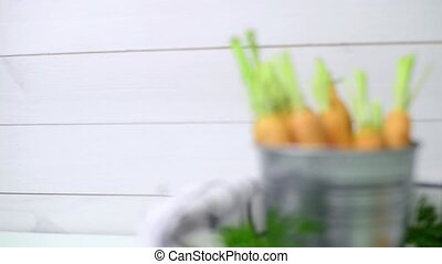 Carrots on wooden table - Carrots inside a metal bucket on...