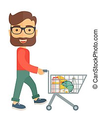 Male Shopper Pushing a Shopping Cart. - A male shopper...