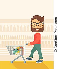 Male Shopper Pushing a Shopping Cart - A male shopper...