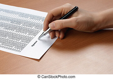 hand with black pen sign the document