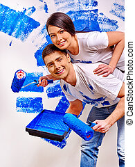 Family paint wall at home. - Happy family paint in blue wall...