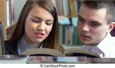 Young people studying in a library. Close up