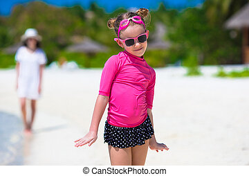 Adorable little girl at beach during summer vacation - Cute...