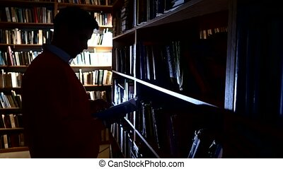 The guy puts the book in its place in the library. leafing...