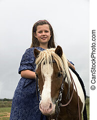 Little Girl With Pony - Little Girl Standing next to her...