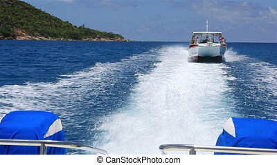 Pleasure boat plies the Indian Ocean Island of Praslin in...