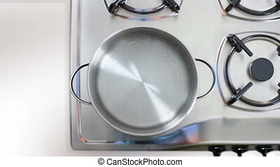 Boiling water on gas flame iniron pan