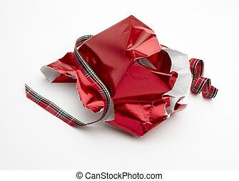 Christmas morning - torn Christmas gift wrap and ribbon shot...