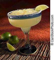 Frozen margarita with lime and salt on the rim