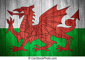 Wales flag or Welsh banner on wooden boards background