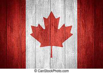 Canada flag or Canadian banner on wooden boards background