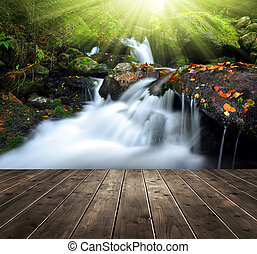 Waterfall with wooden planks