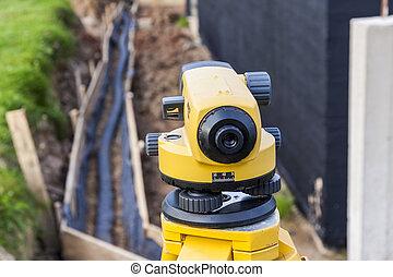 Surveyor equipment optical level at construction site