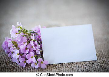 bouquet of spring flowers on the table of burlap