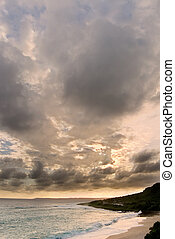 Dramatic sunset clouds in sky over the ocean