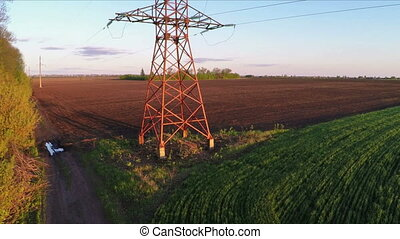 Flying over power line at sunset - Aerial survey - flying...