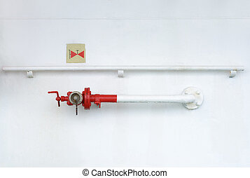 fire hydrant on metal wall with a sign - fire hydrant on a...