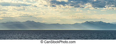 Mountains by the sea in sun - Mountains by the sea in the...