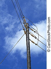 power cables and poles in blue background