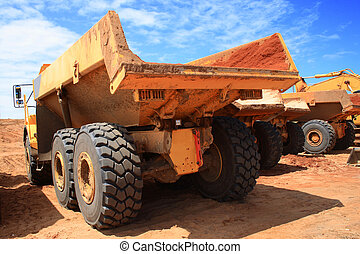 heavy construction truck - the back of two heavy...