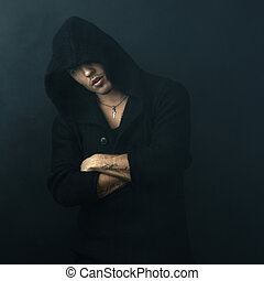 attractive man in black hoodie crossed his arms - attractive...