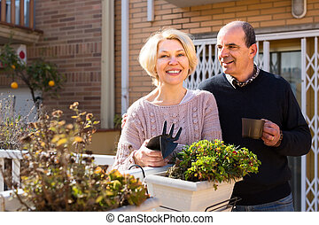 Smiling senior couple outdoors - Smiling senior man and...