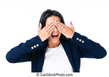 Young businesswoman covering her eyes over gray background