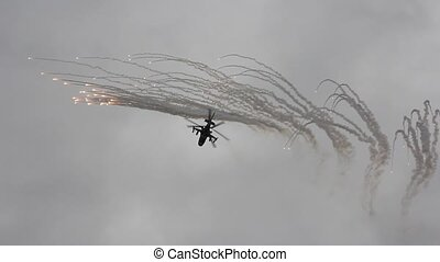 Russian army helicopter Ka-52, alligator performs shooting thermal traps.