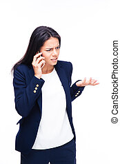 Businesswoman talking on the phone over white background....