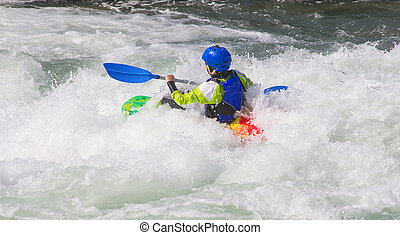 Kayaker - Female kayaker in the white water of tghe river
