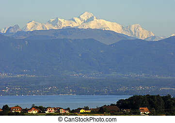 View across the Lac Leman at the snow-covered Mont Blanc massif, France