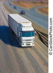 truck moves on highway - big powerful truck moves on highway