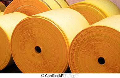 plastic rolls - a few coated plastic rolls waiting to be...