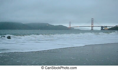 golden gate bridge in san francisco under fog and ocean...