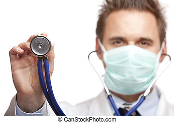 Closeup of doctor holding stethoscope into camera. Focus on stethoscope. Isolated on white.