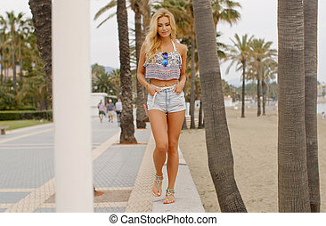 Blond Woman Walking on BeachPromenade - Full Length Front...