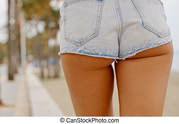 Woman in Denim Shorts Walking on Sidewalk - Rear View Close...