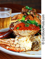 crab meat and beer - crab meat on a plate with beer and...