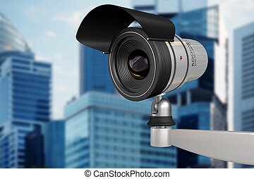 urban surveillance - CCTV security camera on background of...