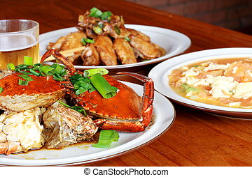unhealthy meal - an unhealthy meal of crab, chicken wings,...