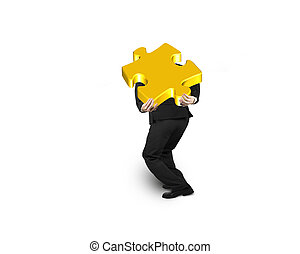 Businessman carrying 3D gold jigsaw puzzle piece isolated on...