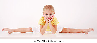 Splits - Cute little girl making splits on white background