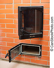 Open red brick oven with ashtray.