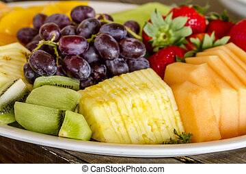 Fruit and Cheese Tray on Display - Tray of assorted fruit at...