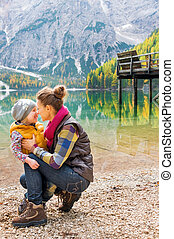 Mother and daughter Eskimo kisses on the shores of Lake...